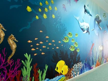 Bespoke colourful underwater themed school corridor wall art