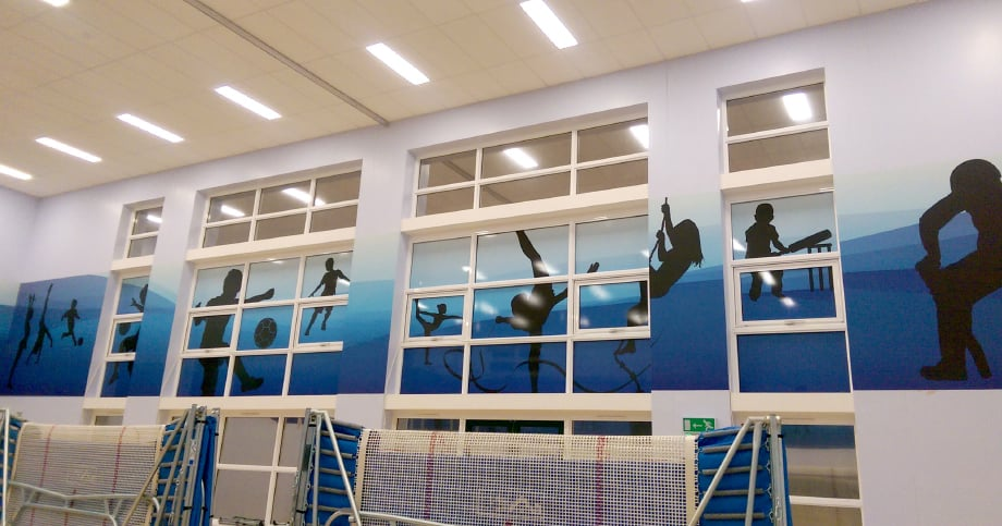 Schools sports hall area with bespoke window vinyl wall art