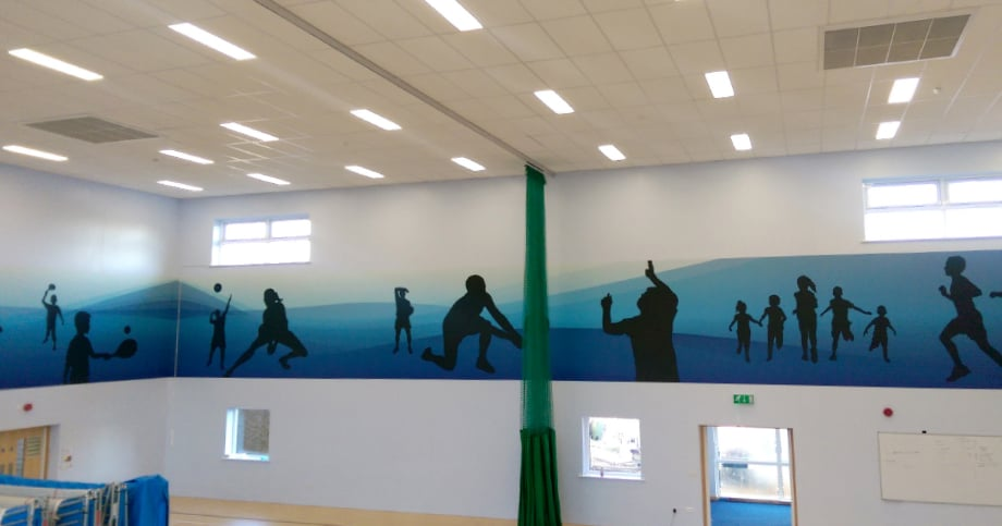 Bespoke design and completed school sports hall installation wall art