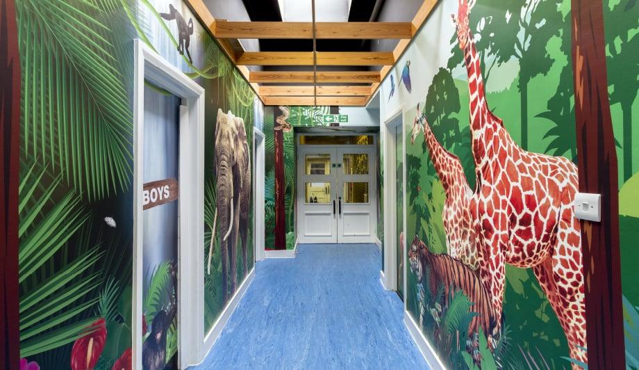 Mottingham Primary School immersive wrap around themed corridor wall art