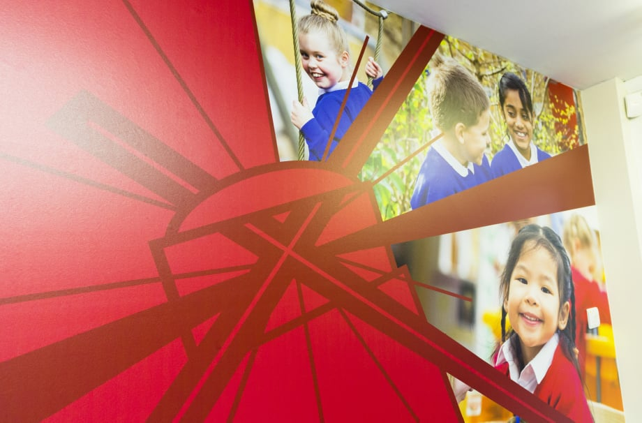 Holy Trinity school custom branding for welcome area wall art