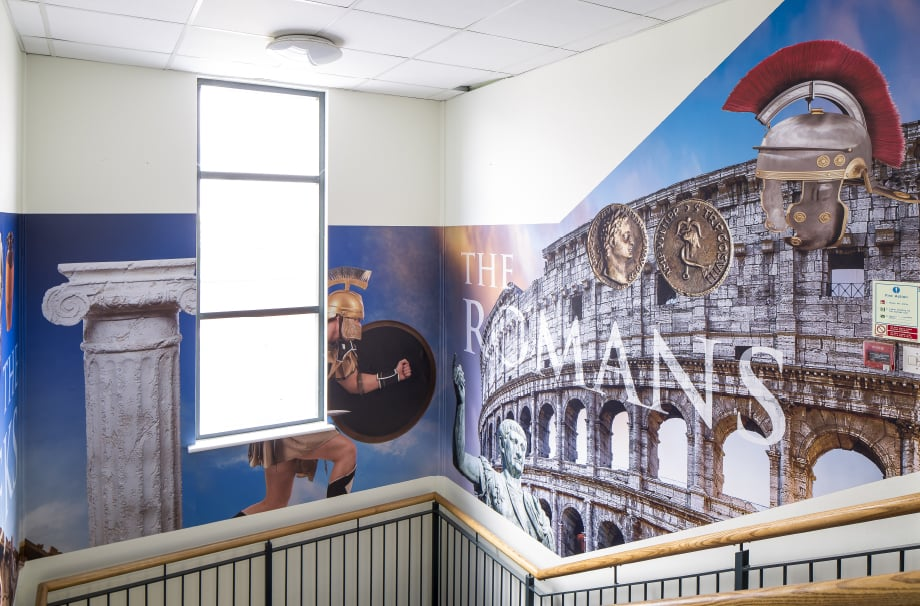 The Romans themed school stairwell makeover wall art