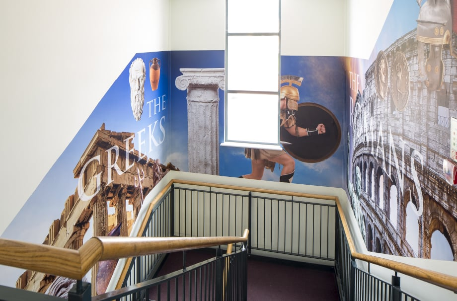 History themed subject zone school stairwell makeover wall art