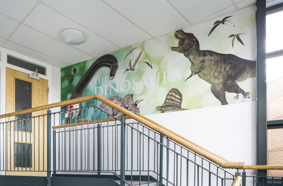 Ravenswood Schools history themed stairway wall art