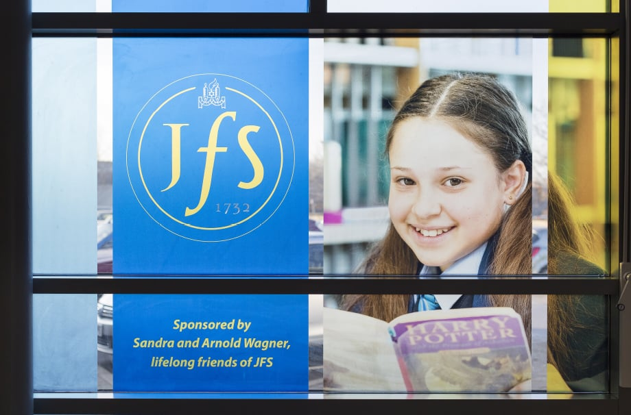 JFS School welcome window wall art featuring student photography