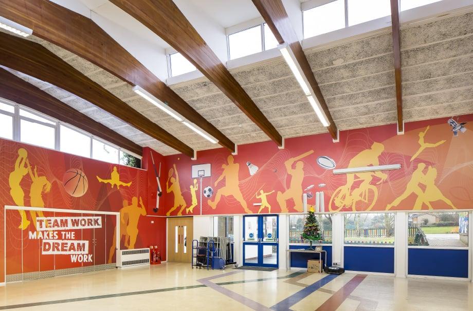 Primary School sports themed bespoke hall wrap wall art