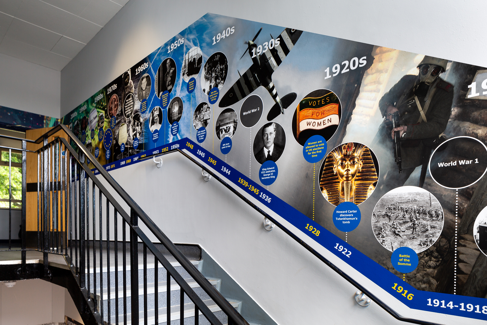 Image of school corridor featuring a historical wall art feature