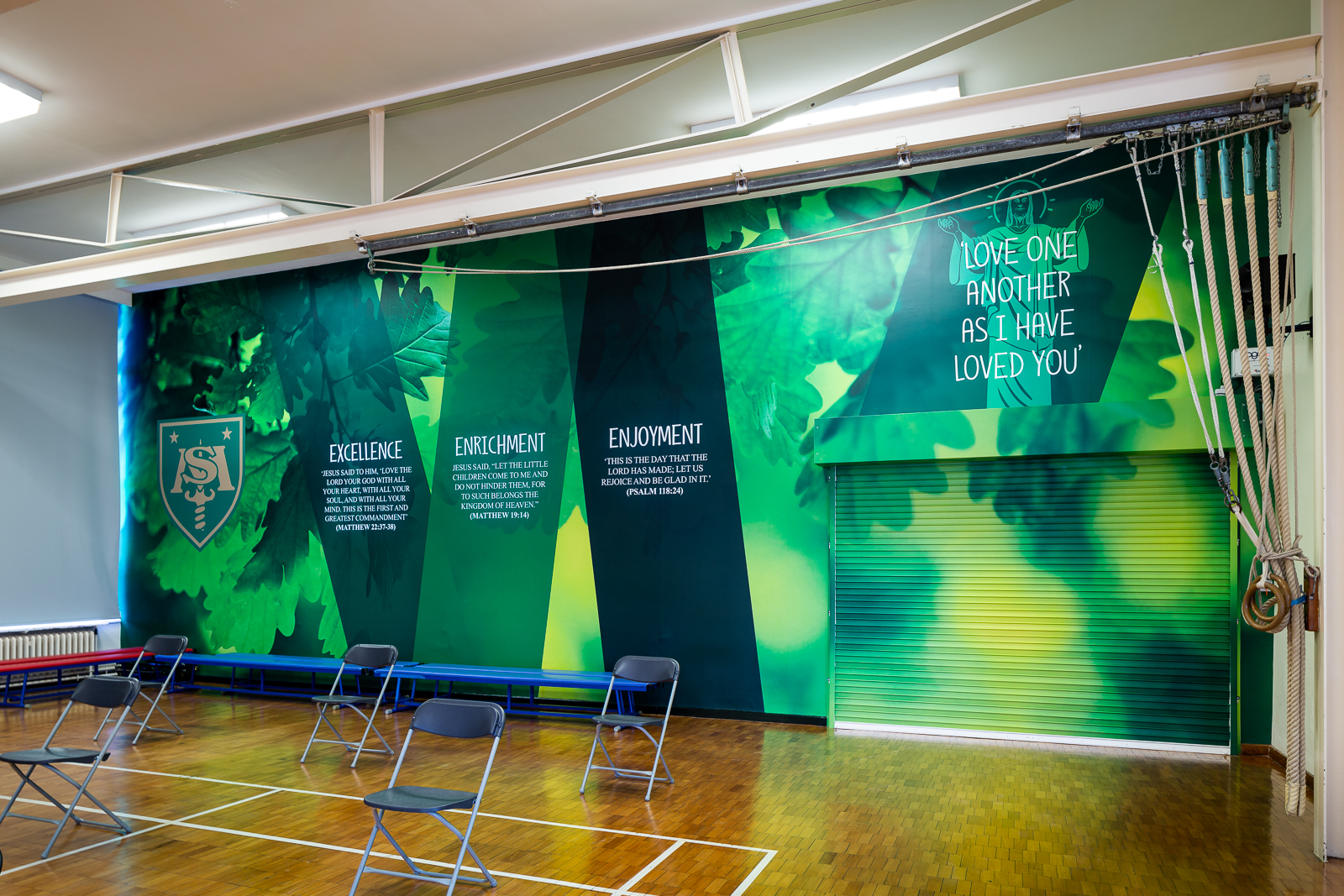 Image of vibrant and bespoke school hall wall art featuring school values